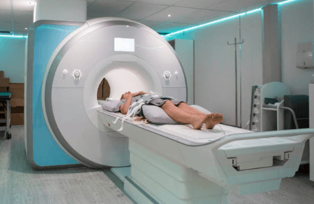woman laying down in an MRI machine